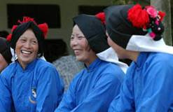 Typical Scene of Luzhi Women Dressed in the Traditional Costume