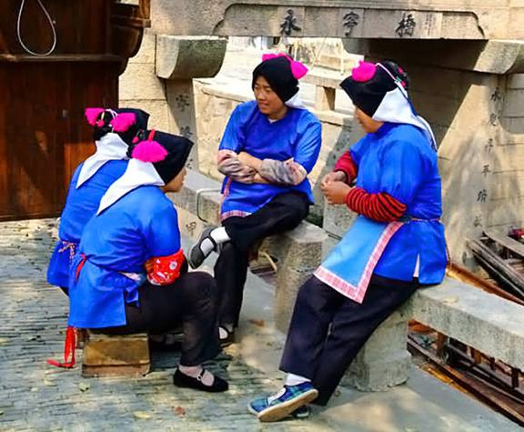 A Typical Scene from Luzhi Water Town Showing a Complete Female Attire