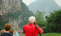 Visitors taking photos of landscape in Guilin