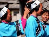 Married Women in Tunbao Village Tied White Clothing on Their Foreheads